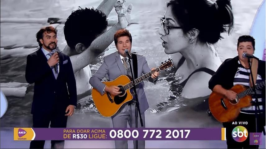 Teleton 2017: Ana Vilela, Daniel e Padre Fábio de Melo cantam 'Trem Bala' (foto/ reprodução SBT)